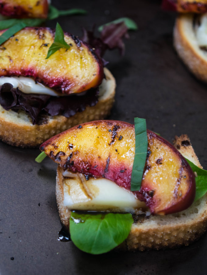 Grilled Peach Crostini with mozzarella, basil and balsamic honey reduction. Perfect balance of sweet and savory for light summer snacking. | thelastcookie.ca