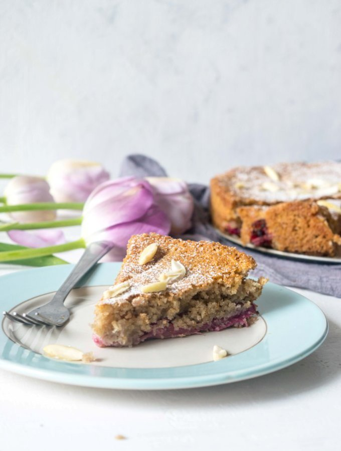 This Gluten Free Rhubarb Cake Recipe is light, incredibly moist and easy to make. A simple but incredibly delicious celebration cake for spring and summer!